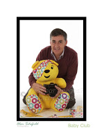 Alan Schofield and Pudsey Bear posing for charity